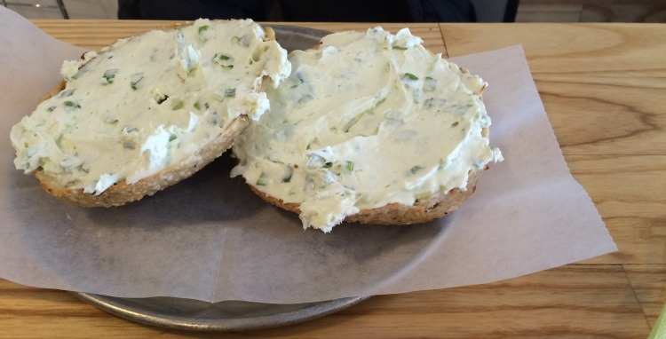 Onion bagel with scallion cream cheese.